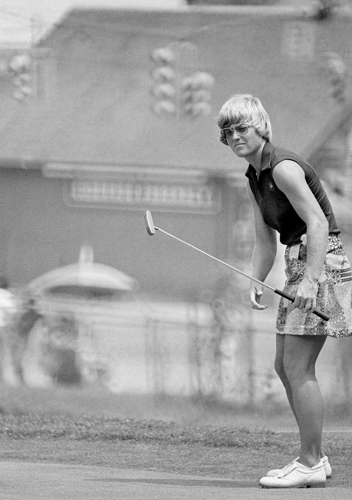 Jerilyn Britz watches a putt roll toward the hold on the 15th green at Brooklawn Country Club in Fairfield, Conn., during the first round of the U.S. Women's Open golf tourney, July 12, 1979. Britz and Deborah Massey finished their rounds with 1-under-par 70s to share the early first-round lead. (AP Photo/Bob Child)