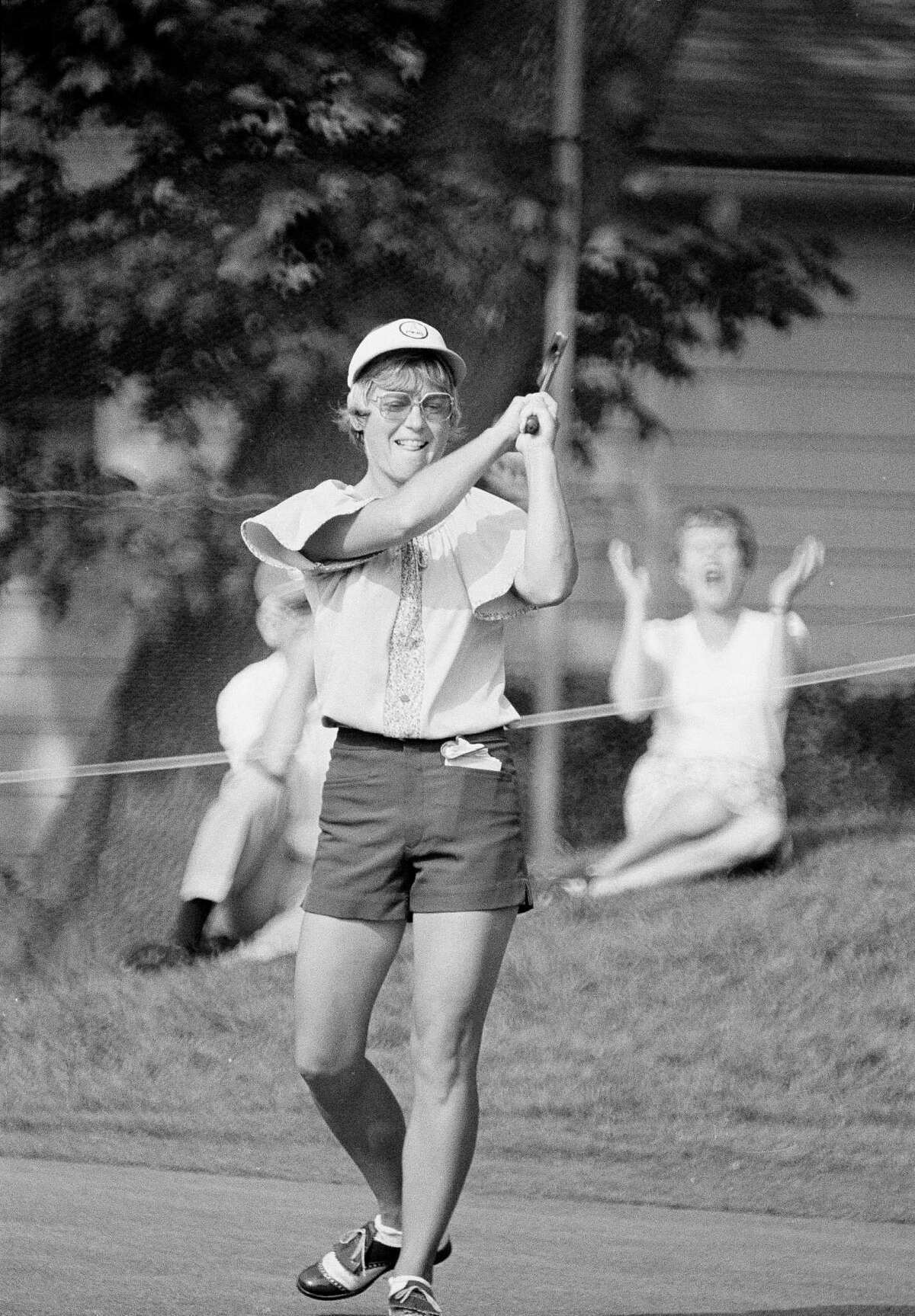 Jerilyn Britz of Luverne, Minn., urges her putt on the ninth green at Brooklawn Country Club in Fairfield, Conn., July 13, 1979, during the second round of the U.S. Women's Open golf tourney. The putt dropped for a birdie three to give her lead in the tourney. Britz has won the open three times. (AP Photo/Bob Child)