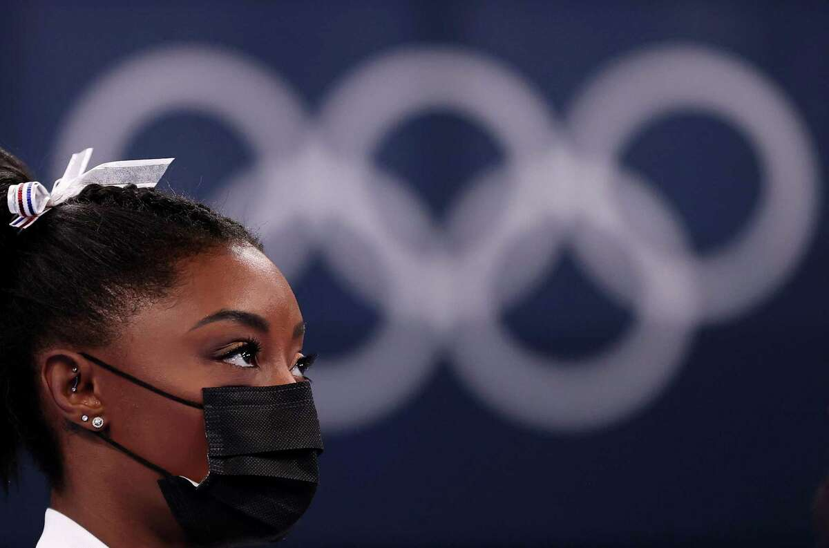TOKYO, JAPAN - JULY 27: Simone Biles of Team United States looks on during the Women's Team Final on day four of the Tokyo 2020 Olympic Games at Ariake Gymnastics Centre on July 27, 2021 in Tokyo, Japan. (Photo by Laurence Griffiths/Getty Images)