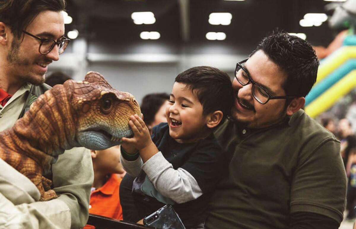 A child pets a baby dino.