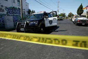 Oakland police on 83rd Avenue near International Boulevard in Oakland, Calif., on Thursday, May 20, 2021.