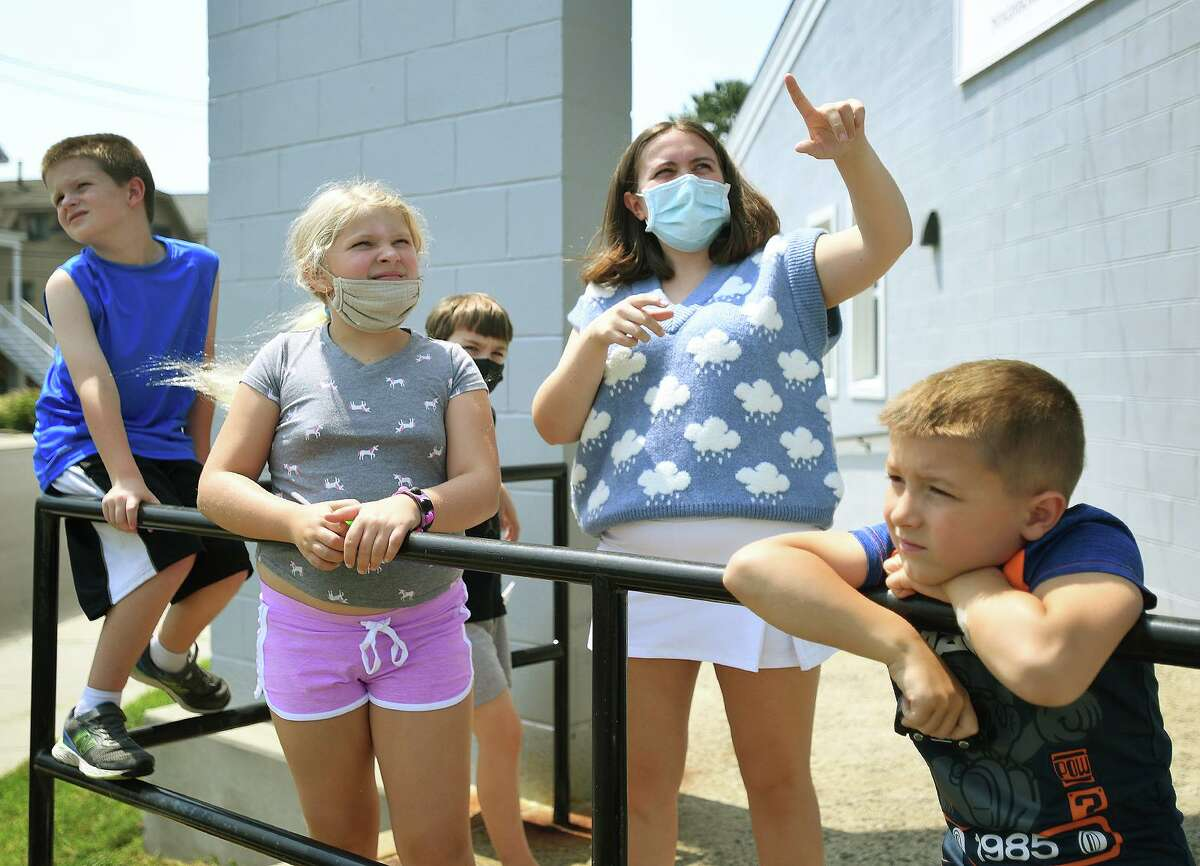 Recent meteorology graduate Veronica Piscitelli points out a variety of cloud types during the Milford Recreation Department's one week summer meteorology camp at the Tri Beach Center in Milford, Conn. on Tuesday, July 27, 2021. From left are Logan Lawless, 9, Remi Brenner, 9, Ian Bear, 9, Piscitelli, and Michaerl Pietrini, 6.