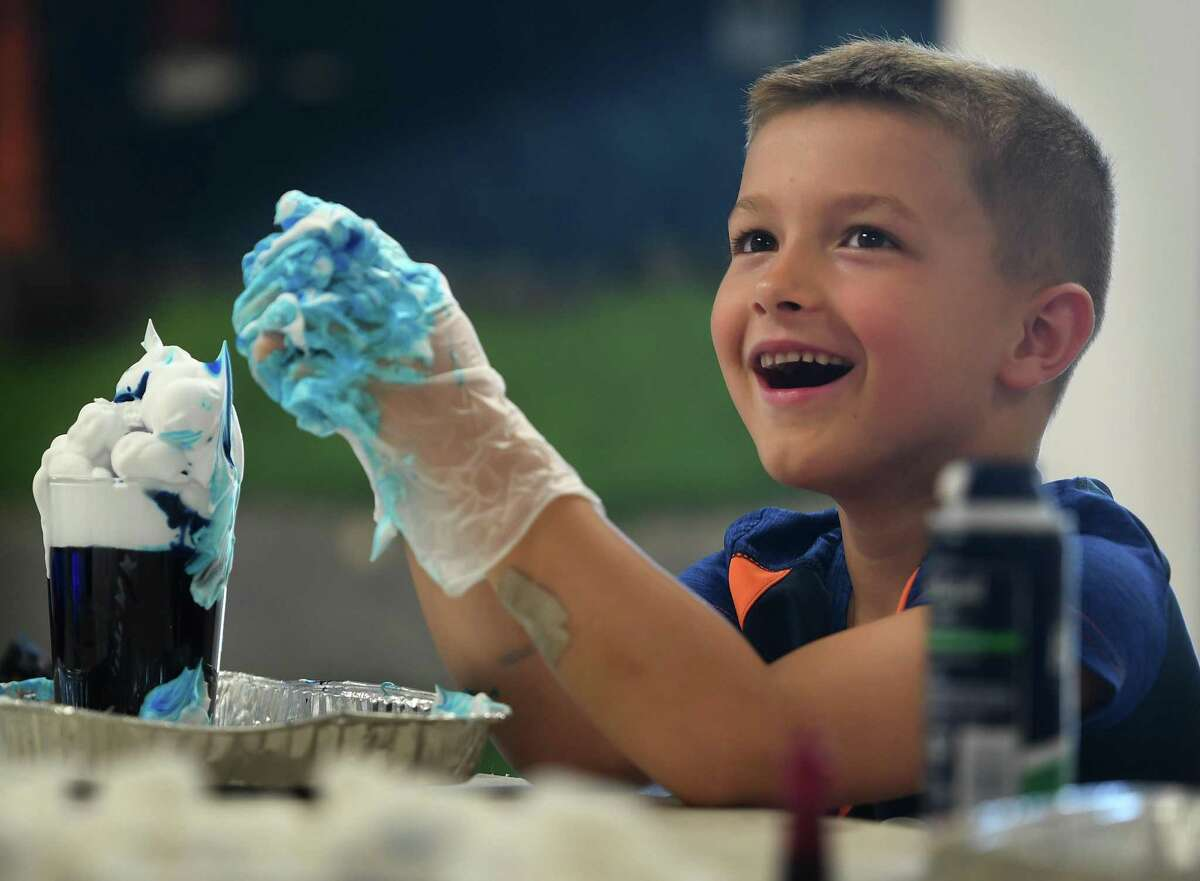 Michael Pietrini, 6, of Milford, builds a rain cloud with shaving cream and blue food coloring during the Milford Recreation Department's one week summer meteorology camp at the Tri Beach Center in Milford, Conn. on Tuesday, July 27, 2021.