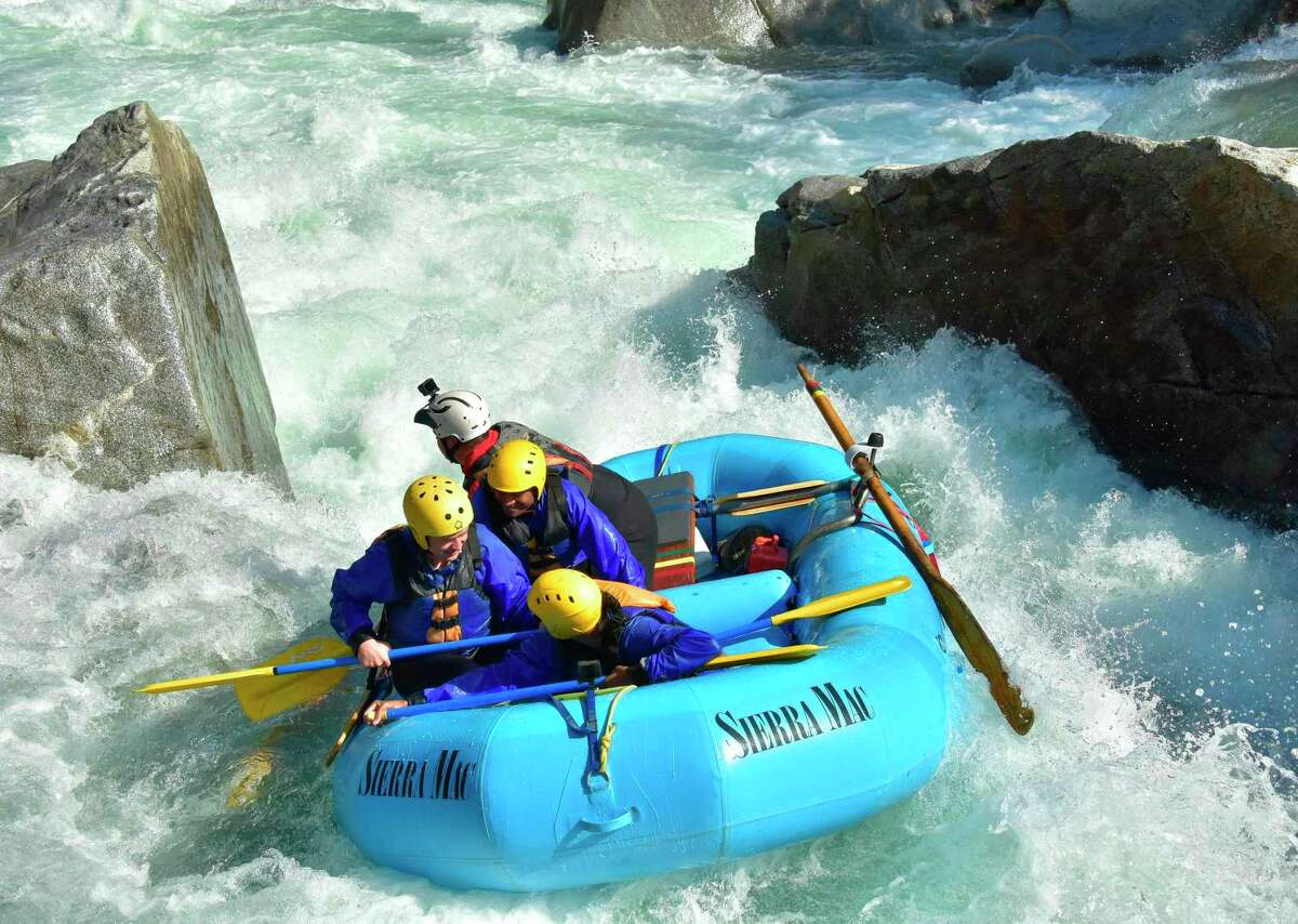 Rafters take advantage of the Tuolumne River rapids. Outfitters are able to keep operations running during such a dry year with the help of water agencies.