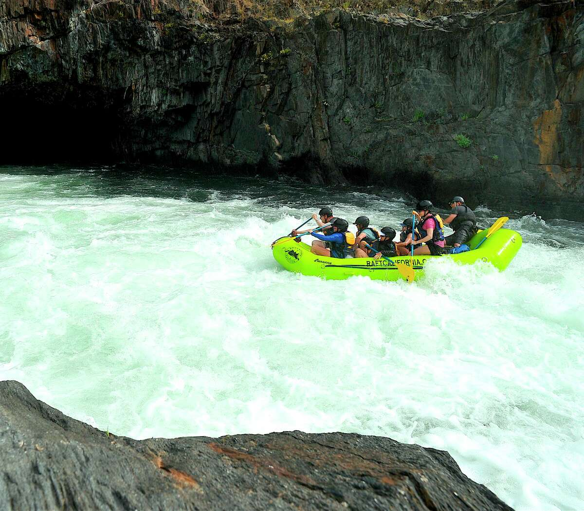 A rafting trip starts the plunge down Tunnel Chute on the Middle Fork American River, a white-water cascade where you sail down through what feels like a tunnel hole in the rock. It was created by miners during the Gold Rush.