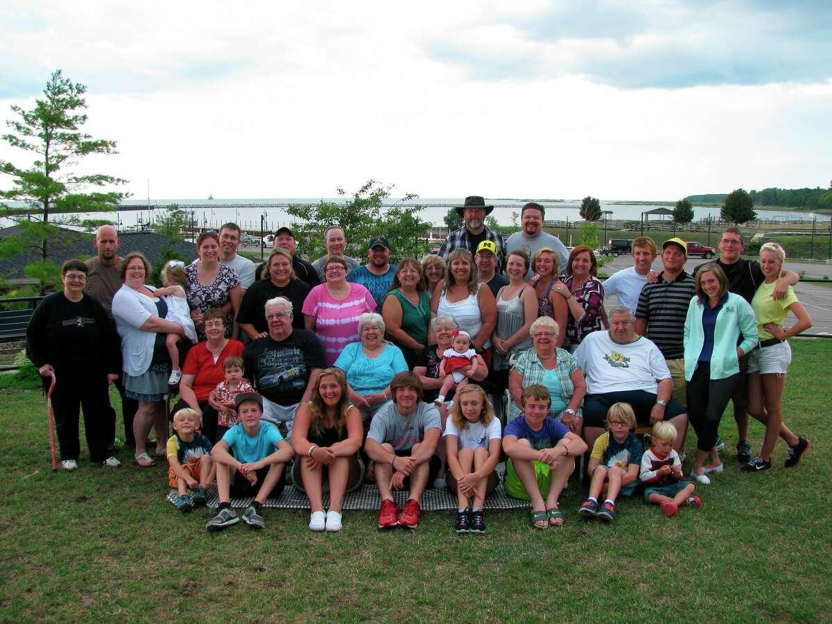Cugini's family poses for a photo near the Port Austin marina in 2012.(Courtesy Photo)