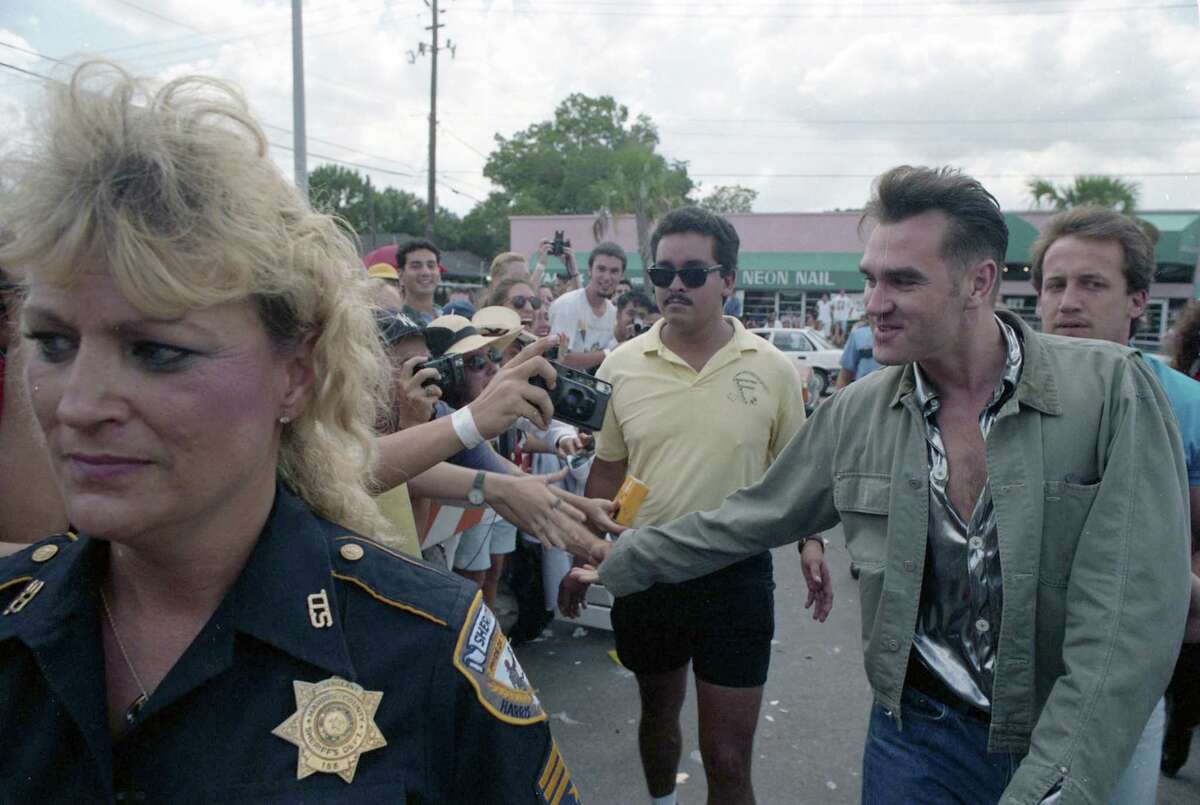Morrissey arrives at Record Rack, 3109 South Shepherd, July 29 1992.