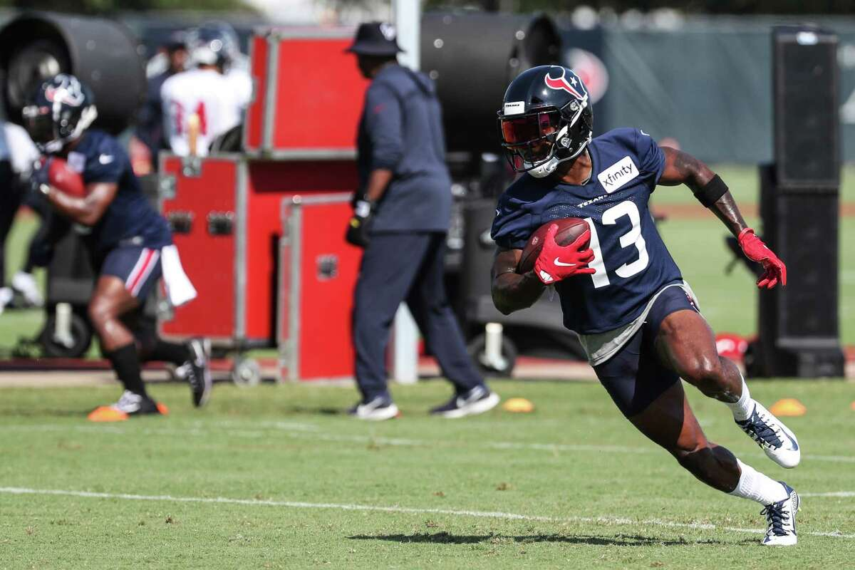 Houston Texans wide receiver Brandin Cooks turns the ball up the field after making a catch during an NFL training camp football practice Wednesday, July 28, 2021, in Houston.
