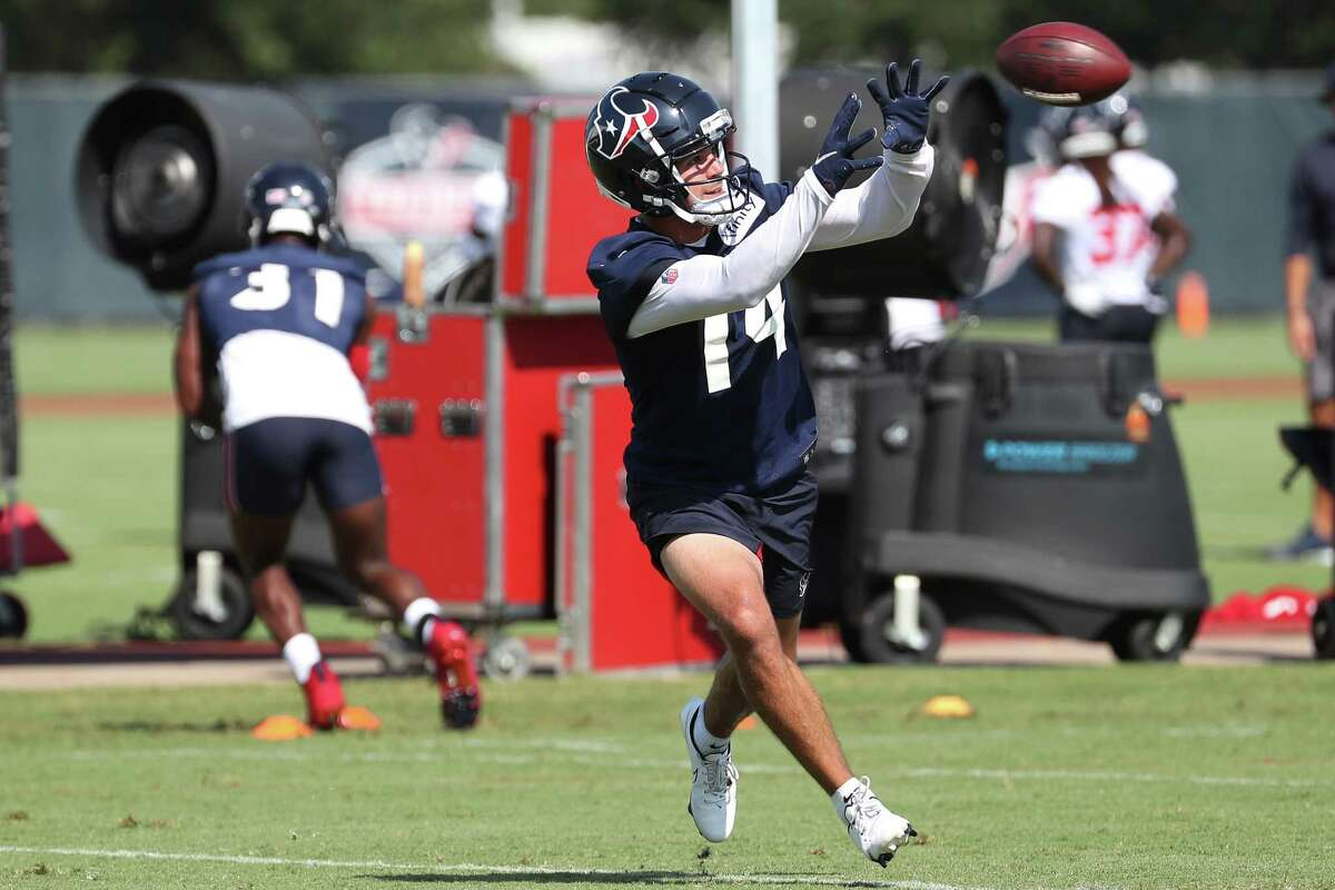 Houston Texans wide receiver Alex Erickson (14) reaches out to make a catch during an NFL training camp football practice Wednesday, July 28, 2021, in Houston.