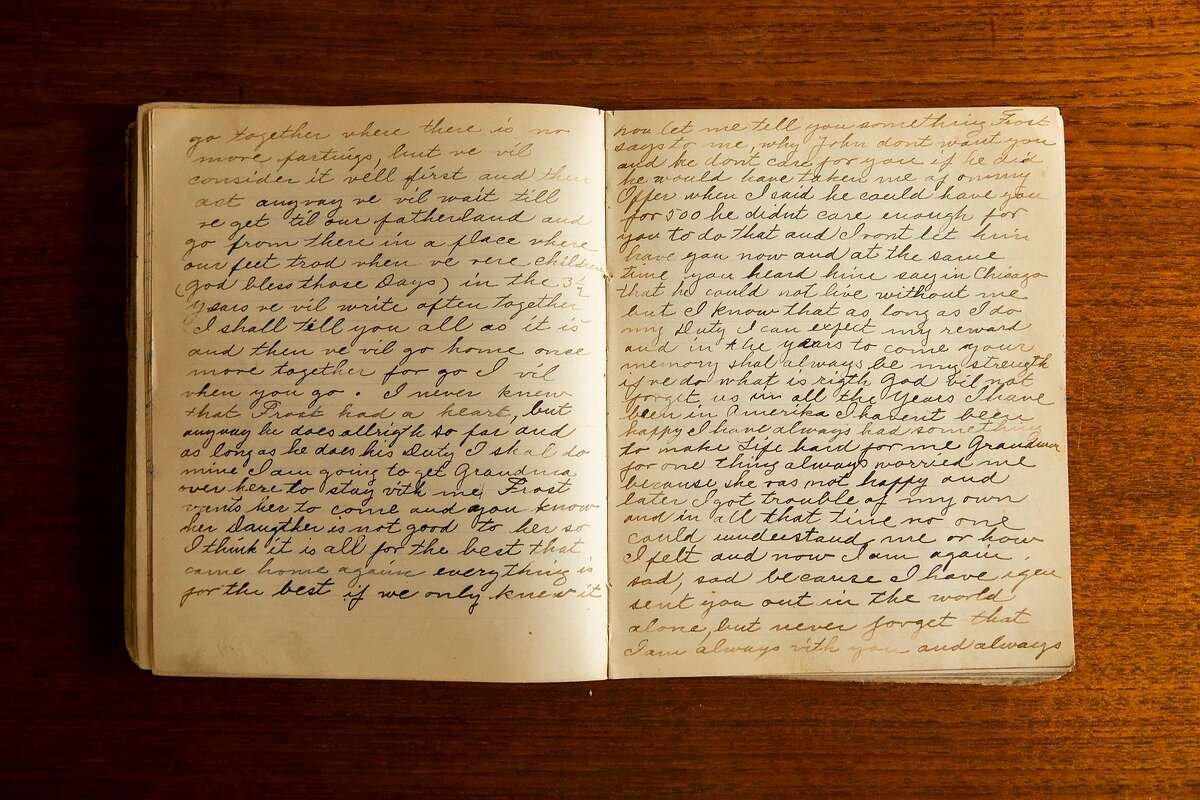 A passage from an old, worn diary unearthed by Christine Lalanne while renovating her Sunset District home is seen on her dining room table in San Francisco, Calif. Wednesday, July 21, 2021. While doing construction at her home in the Sunset, Lalanne discovered a pair of diaries that had been stashed away for a century. Written in two different hands, they hinted at an unfulfilled romance between Hans, the architect who built the house, and a woman named Anna who was not his wife. Christina spent more than a year deciphering the diaries and tracking their writers, traveling back to their home town in Denmark to uncover their story.