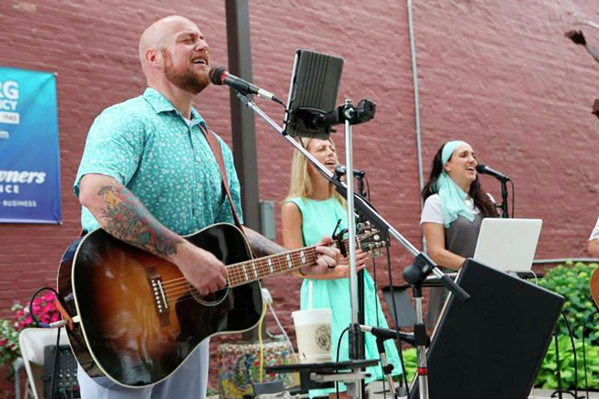 Chris Jane, left, performs with friends Kristin Malloy, of Canadian Lakes, Beth Cousineau, of Stanwood, and Rob Camper, of Paris atBig RapidsPocket Park in 2017. Hereturnsto the annual summer music series thisFriday.(Pioneer file photo)