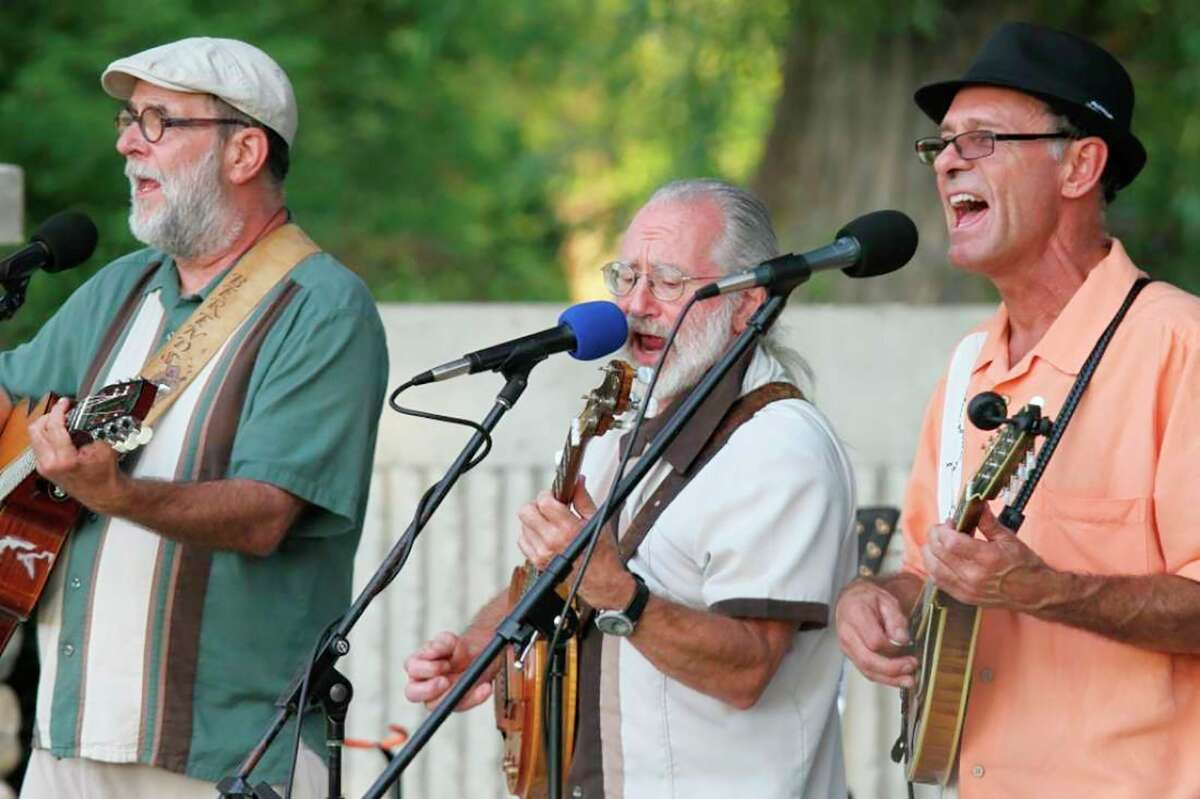 """From left to right, Bear Berends, """"Banjo"""" Jim Foerch and Tom Devries, otherwise known as the Blue Water Ramblers, strum out a songas part of theBig Rapids Band Shell Summer Concert Seriesin 2012. They will play atMecosta's Music on the Riverthis Friday evening.(Pioneer file photo)"""