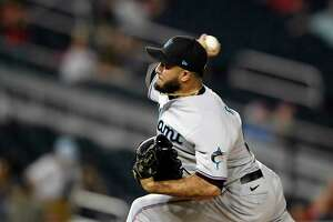 Miami Marlins relief pitcher Yimi Garcia throws during the 10th inning of the team's baseball game against the Washington Nationals, Wednesday, July 21, 2021, in Washington. The Marlins won 3-1. (AP Photo/Nick Wass)