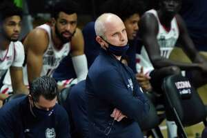 UConn head coach Dan Hurley watches from the sideline in the second half of an NCAA college basketball game against St. John's in Storrs, Conn., Monday, Jan. 18, 2021.