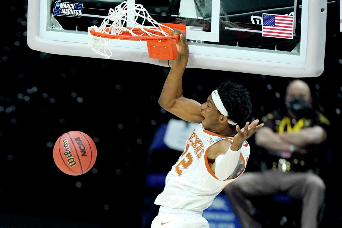 In this March 20, 2021, file photo, Texas' Kai Jones dunks against Abilene Christian during the first half of a college basketball game in the first round of the NCAA tournament at Lucas Oil Stadium in Indianapolis. Jones is a first-round prospect in this year's NBA draft.
