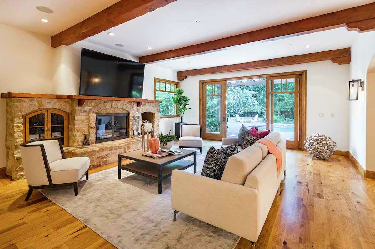 In the main house, which spans 8,500 square feet, there are five bedrooms and eight bathrooms. There's a mountain house vibe, with tall, beamed ceilings and lots of stone, wood and decorative ironwork.