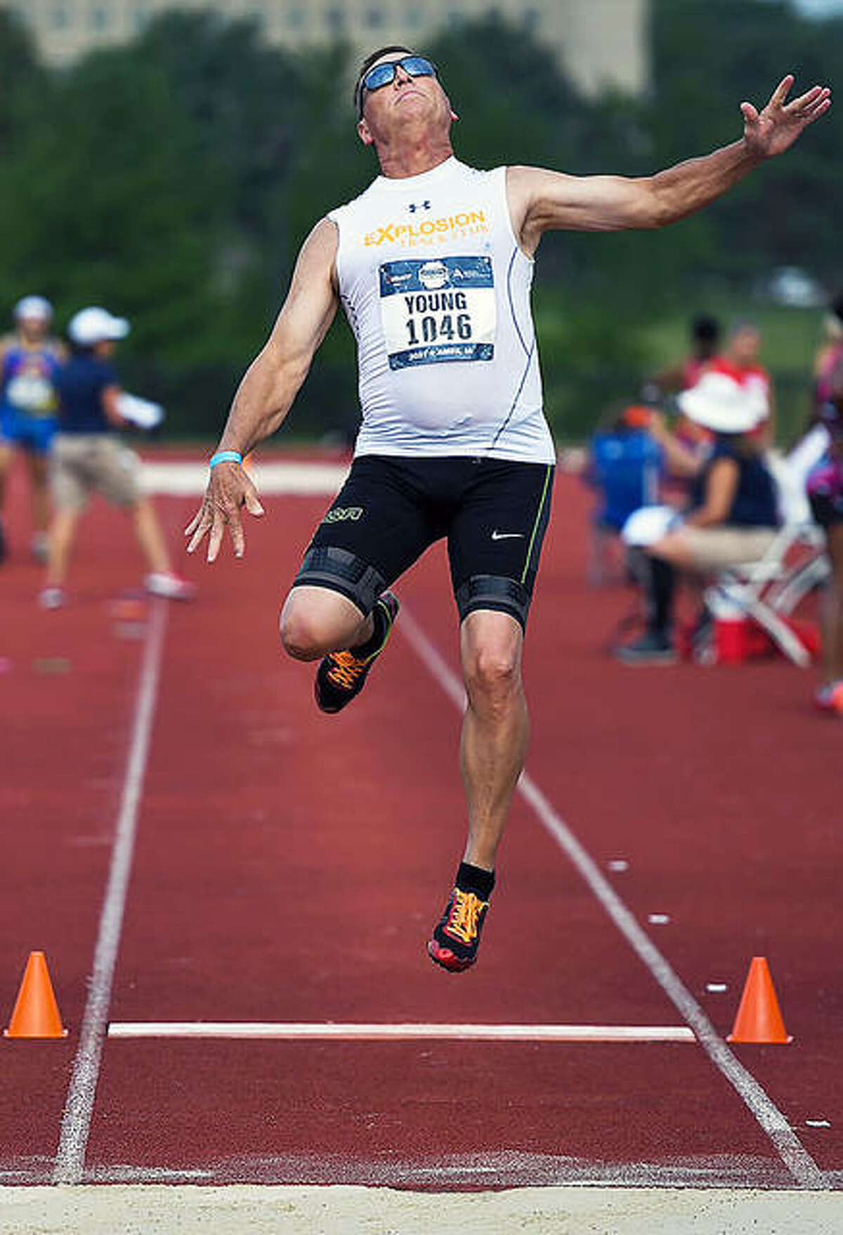 Mike Young of Wood River competes in the long jump at the USA Track and Field Masters Outdoor Championships at the Iowa State University Cyclone Sports Complex. Young finished eighth in the event at the four-day nationals