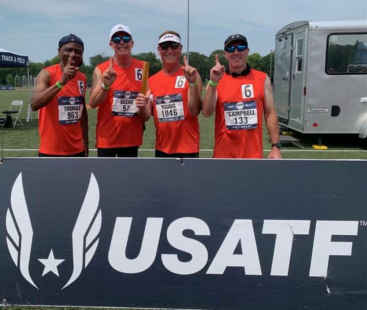 Wood River's Mike Young (second from right) and the other members of their national champion 400-meter relay team.