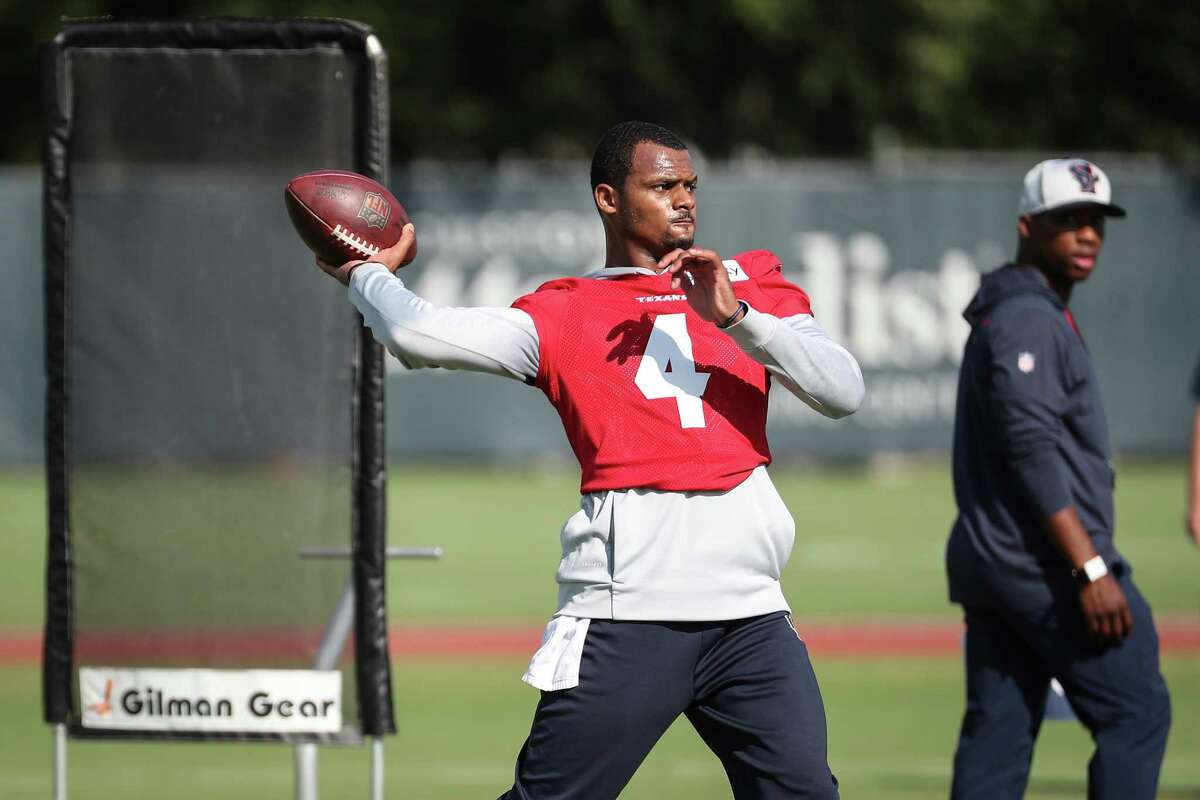 Houston Texans quarterback Deshaun Watson (4) drops back to pass during an NFL training camp football practice Wednesday, July 28, 2021, in Houston.
