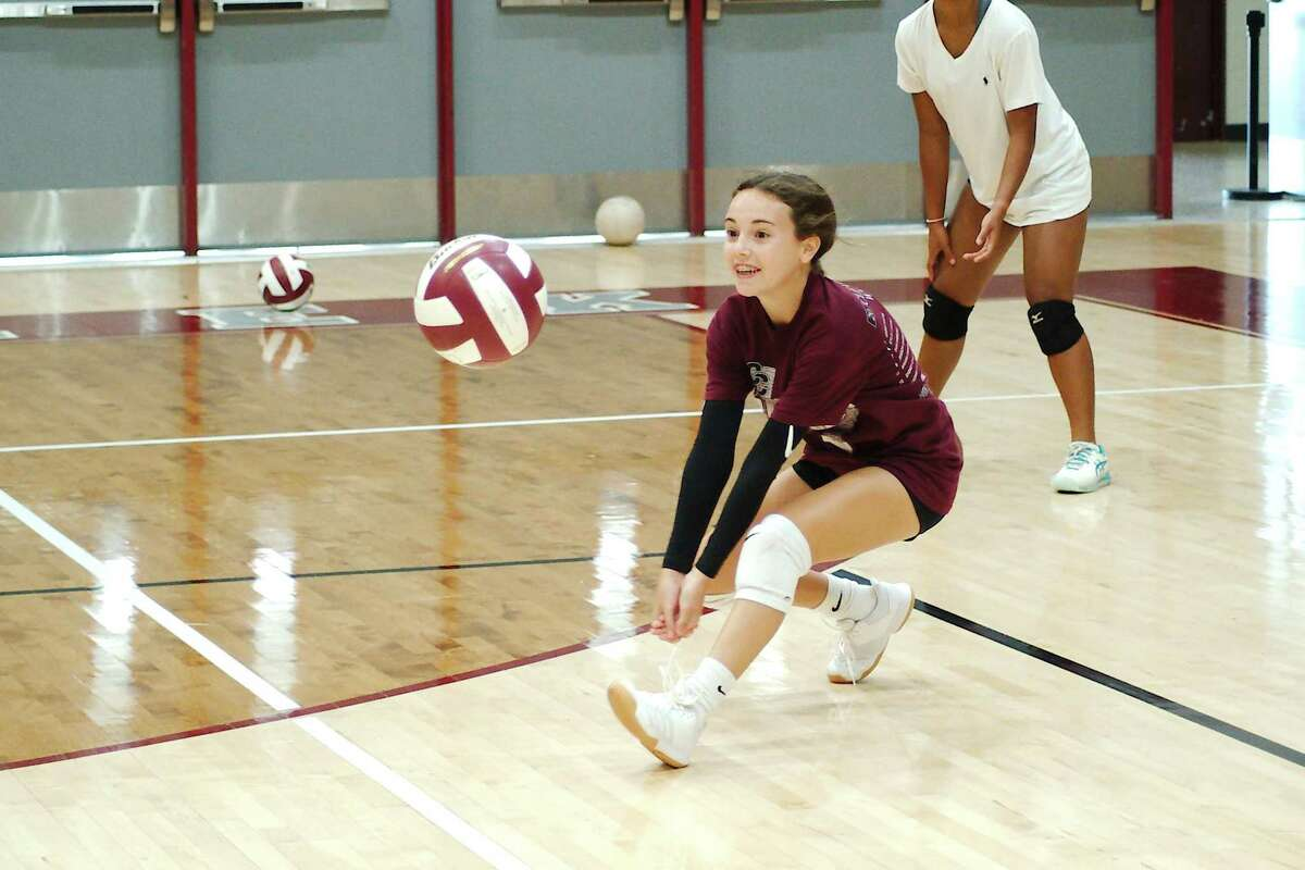 Karina Sweet sets the ball during a mock game drill Wednesday at the Clear Creek Wildcat volleyball camp.