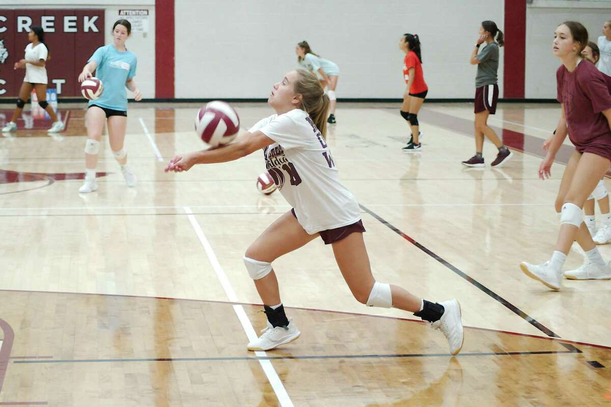 Madison Mason sets the ball Wednesday during a mock game drill at the Clear Creek Wildcat volleyball camp.