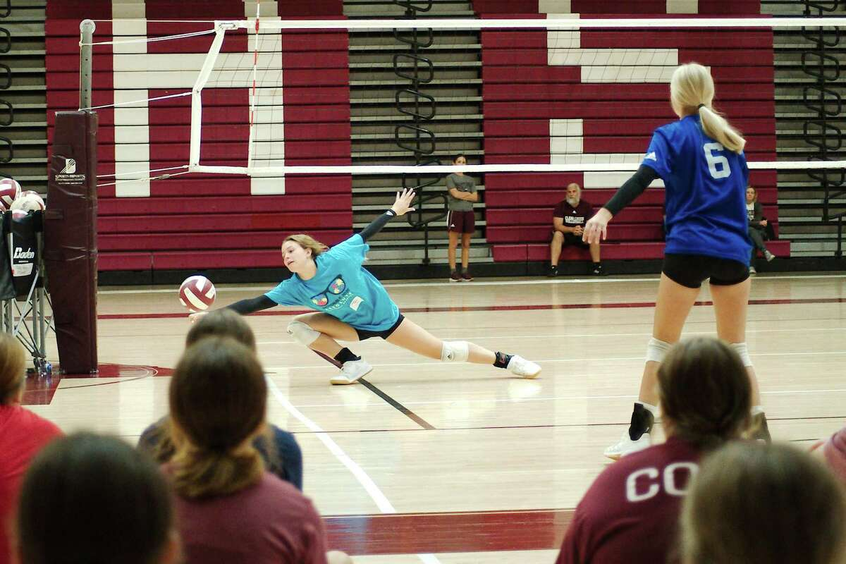Olivia Jones and Elle Dobzyniak demonstrate a drill Wednesday at the Clear Creek Wildcat volleyball camp.