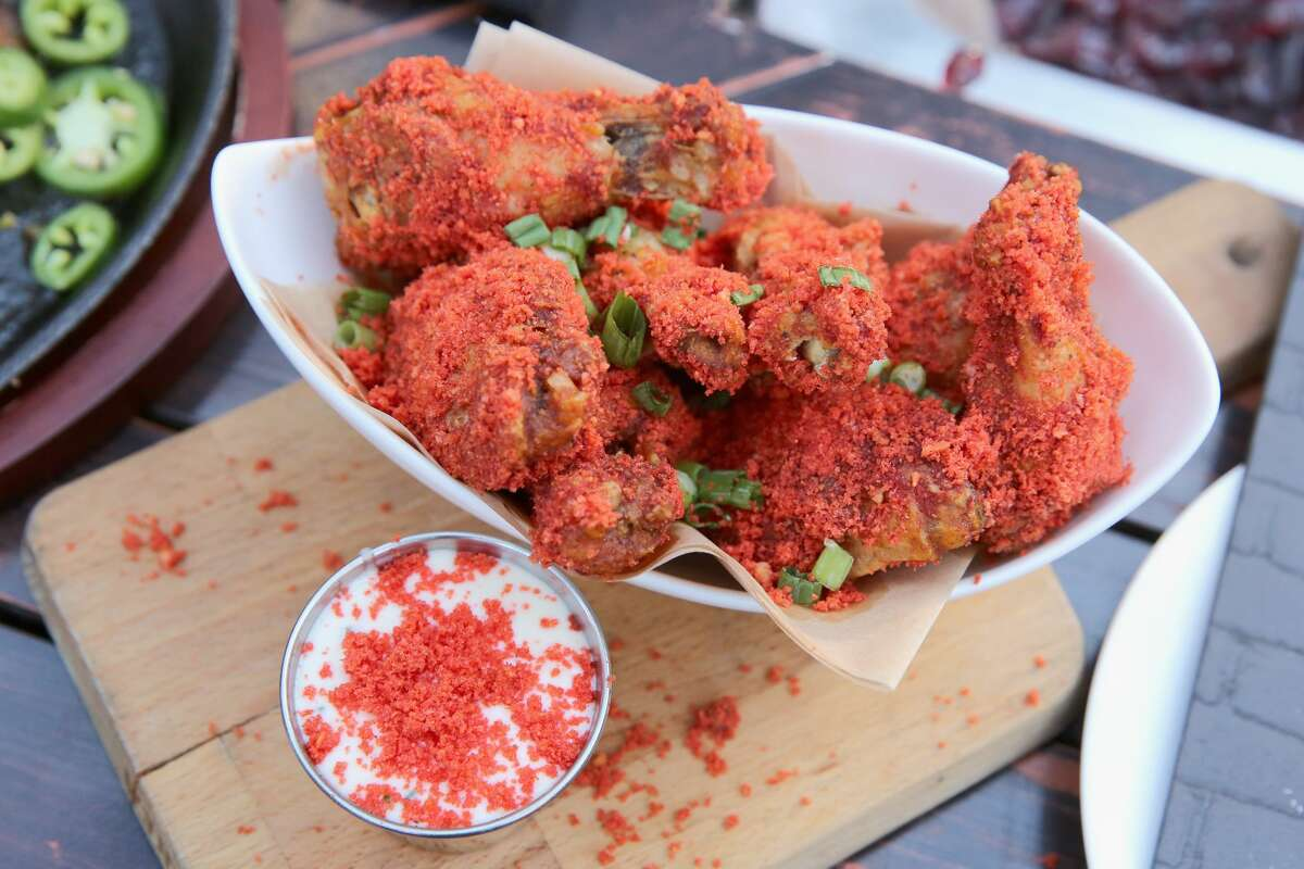 Food covered in hot red dust that will never leave your fingers? These Houston spots got it.