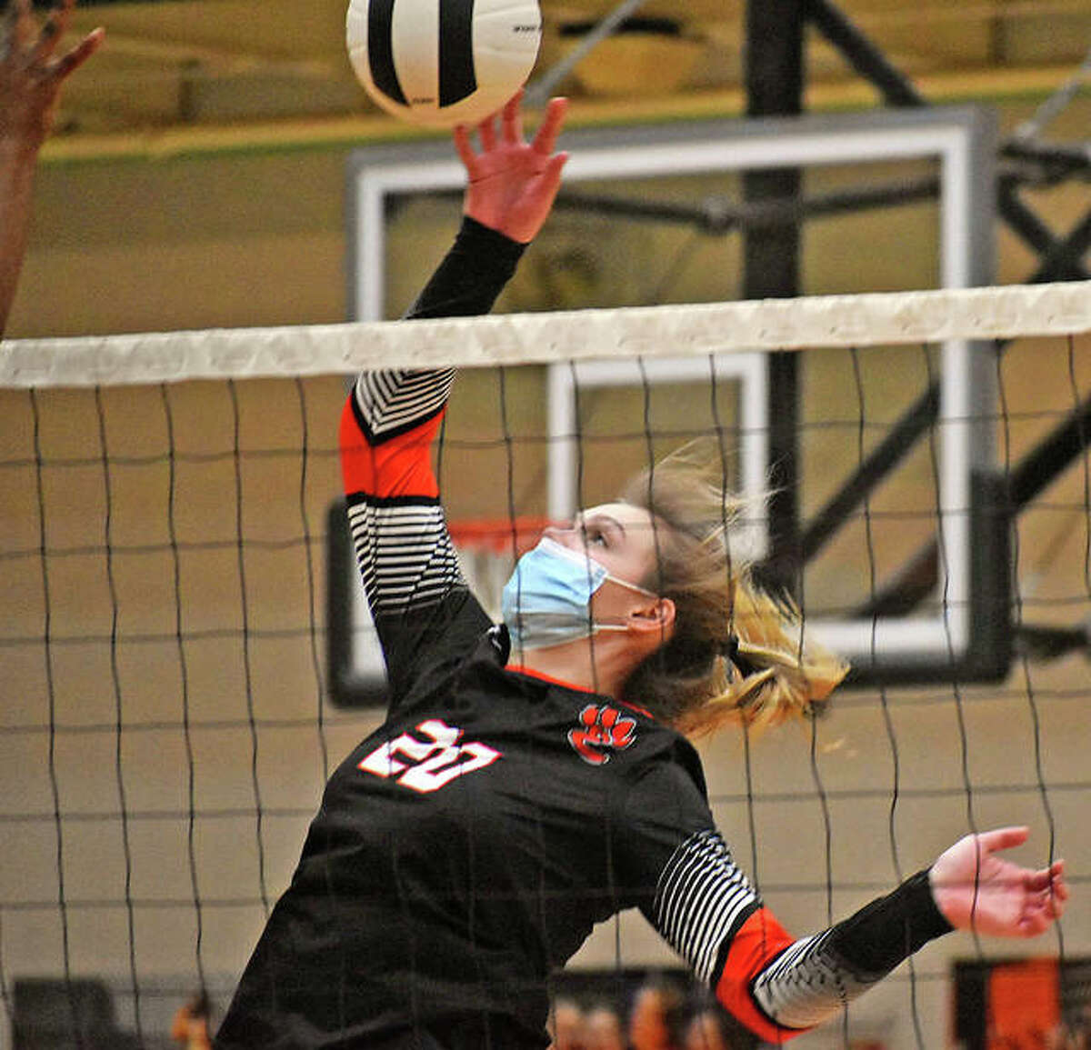 Edwardsville's Storm Suhre attacks during a match for the Tigers last spring. Suhre was a four-year starter and three-time All-SWC pick for the Tigers.