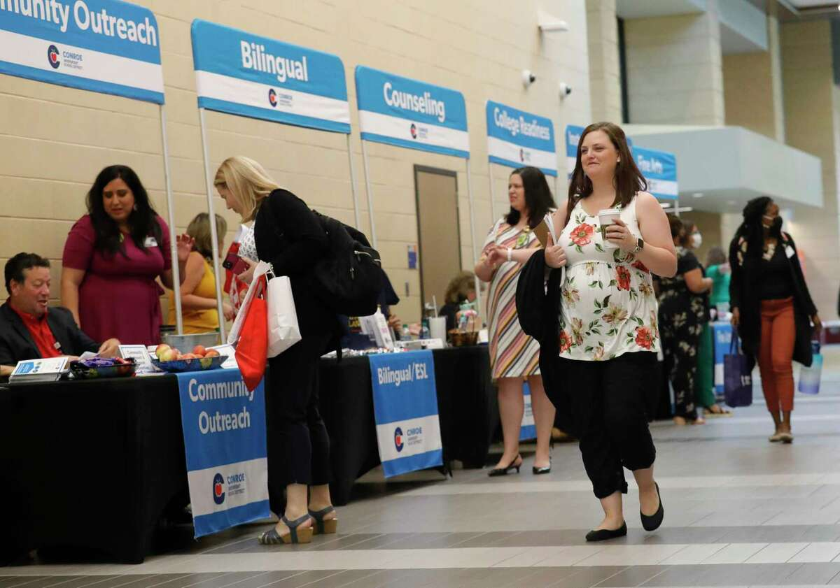 New teachers to Conroe ISD walk through various booths during new teacher orientation at Grand Oak High School, Wednesday, July 28, 2021, in Spring. The district hired more than 600 teachers for the upcoming school year.