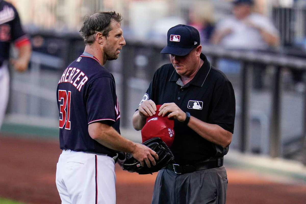 Washington Nationals ace Max Scherzer, shown having his gear inspected by umpire Chad Whitson in a July 2 game against the Dodgers, remains a desirable arm as MLB's trade deadline nears.