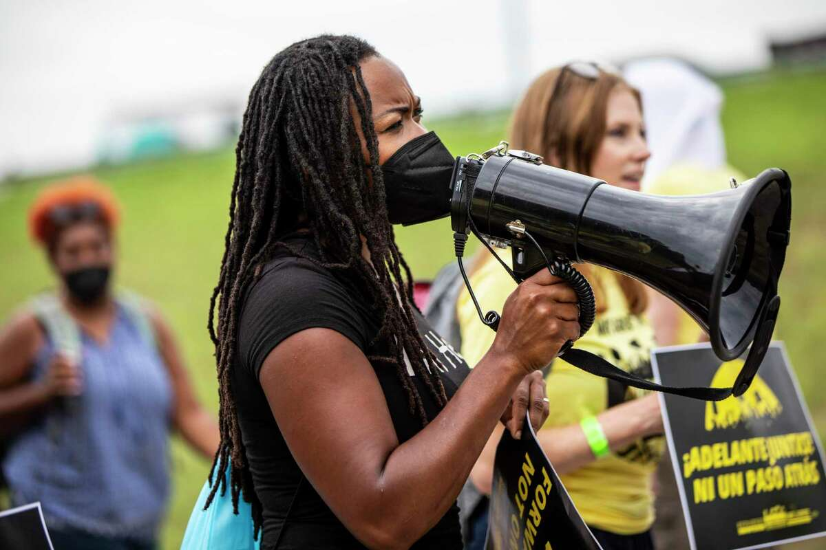 Aya Fubara Eneli, 50, center, speaks through a megaphone during a voting rights march starting in Georgetown, Tx. on Wednesday, July 28, 2021. The Republican-controlled Texas legislature, now in a special session, is poised to pass a number of bills that opponents say would limit the acess to voting for millions of Texans across the state. The Voting Rights March will end at the Texas Capitol in Austin on Saturday.
