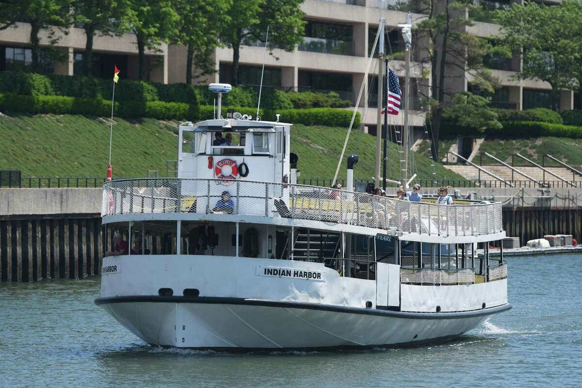 The Island Beach Ferry, one of the vessels providing ferry service for the town, passes through Greenwich Harbor.