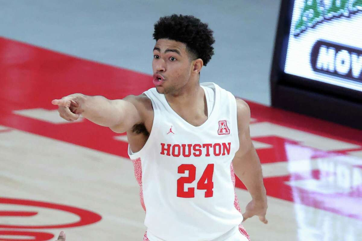 Quentin Grimes #24 of the Houston Cougars reacts after a basket during the first half of a game against the Cincinnati Bearcats at the Fertitta Center on February 21, 2021 in Houston, Texas.