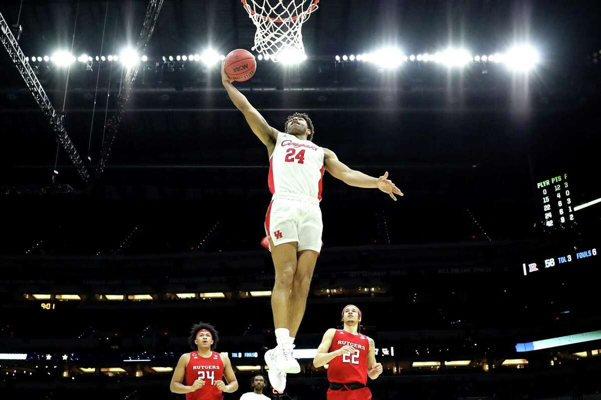 Quentin Grimes #24 of the Houston Cougars dunks the ball during the second half against the Rutgers Scarlet Knights in the second round game of the 2021 NCAA Men's Basketball Tournament at Lucas Oil Stadium on March 21, 2021 in Indianapolis, Indiana.