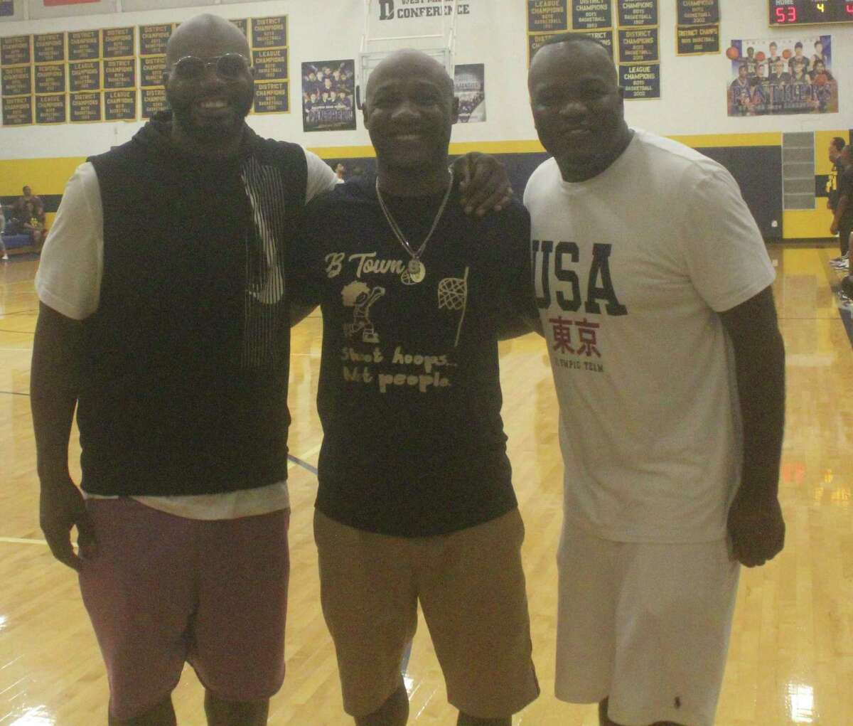 Former Baldwin athletic director Shawn Williams (center) is pictured with fellow Baldwin alums Donte Hill (left) and Ira Childress at Saturday's alumni basketball game. (Star photo/John Raffel)