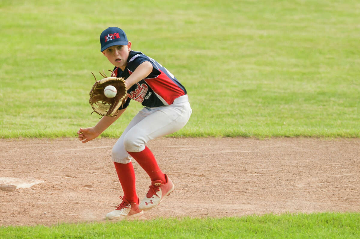 Midland Fraternal Northwest's Eli Piotrowski fields the ball during a state semifinal game against Grosse Pointe Farms-City Wednesday, July 28, 2021 in Bay City. (Katy Kildee/kkildee@mdn.net)