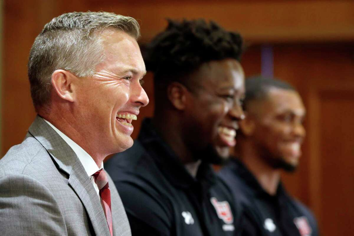 """From left, Lamar University head coach Blane Morgan, tight end Jeremy Davis and defensive back Anthony """"TJ"""" Ruffin laugh as they answer questions during a press conference at the WAC football media day Wednesday, Jul. 28, 2021, held at the Marriott Hotel in The Woodlands, TX."""