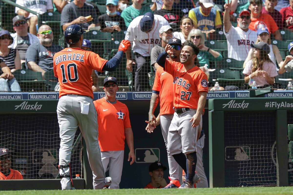Yuli Gurriel celebrates with teammate Jose Altuve after a solo home run during the fifth inning of the Astros' 11-4 victory in Seattle on Wednesday. That gave the Astros two of three wins in the series.