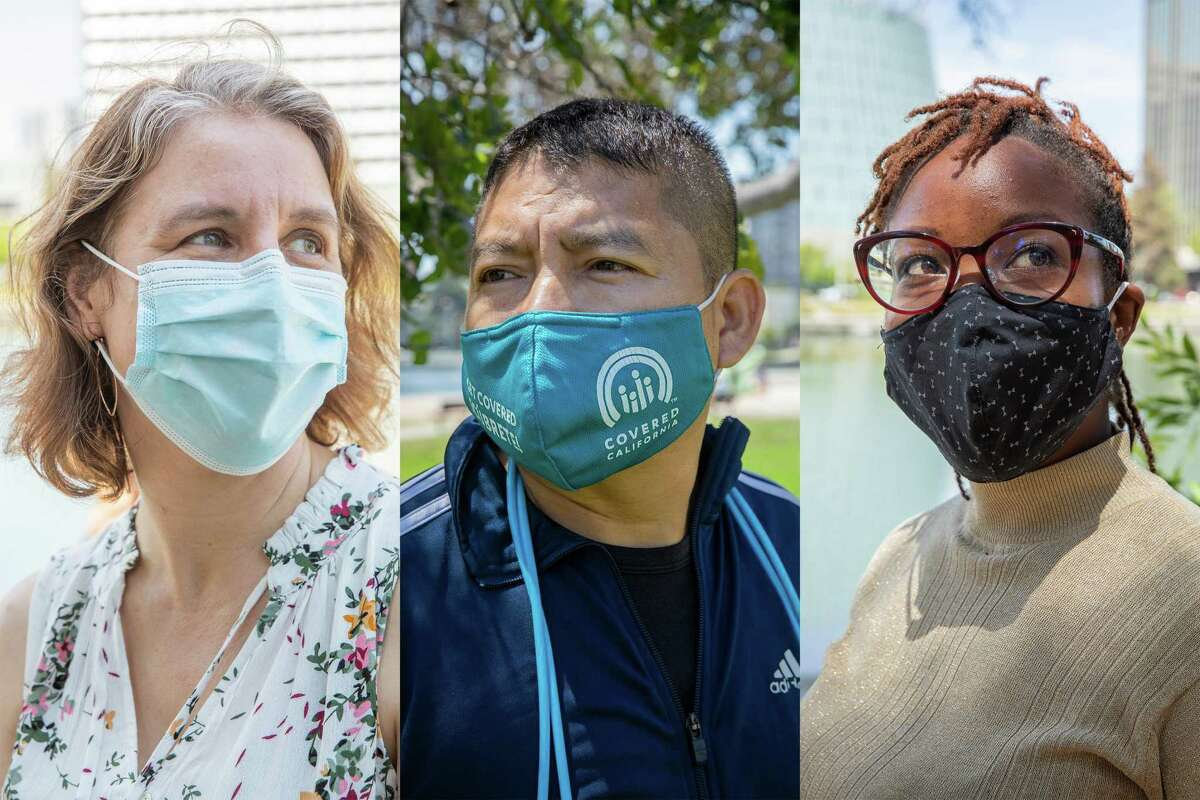 From left, Claire Ramsey, Hernan Morales and Njeri Karanja wear masks at Lake Merritt in Oakland on Wednesday. Many Bay Area residents support stronger masking recommendations.