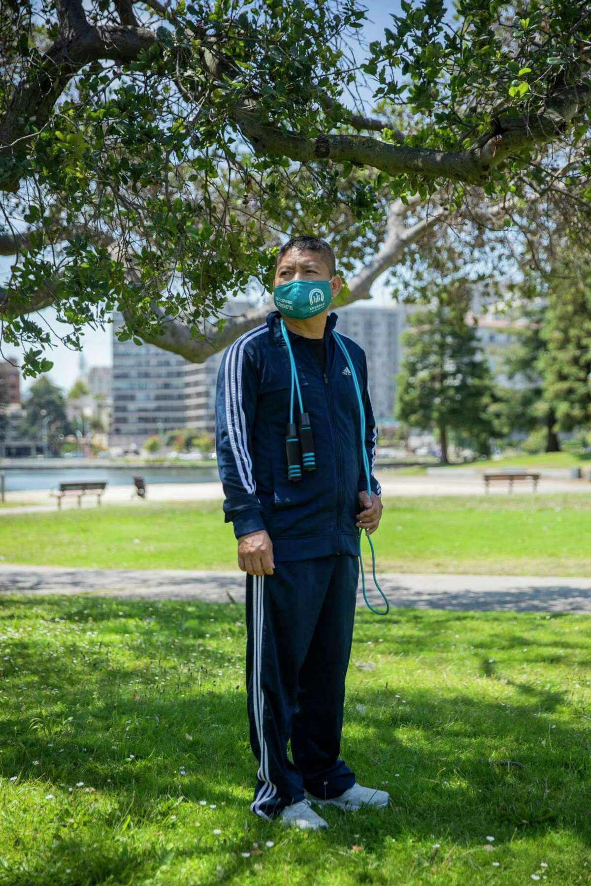 """Njeri Karanja is willing to follow the safety protocols but says she is very tired of it all.  Hernan Morales works at Lake Merritt in Oakland: """"We need to take care of each other.""""Claire Ramsey has a son who is too young to be vaccinated, so she is even more careful than she would have been."""