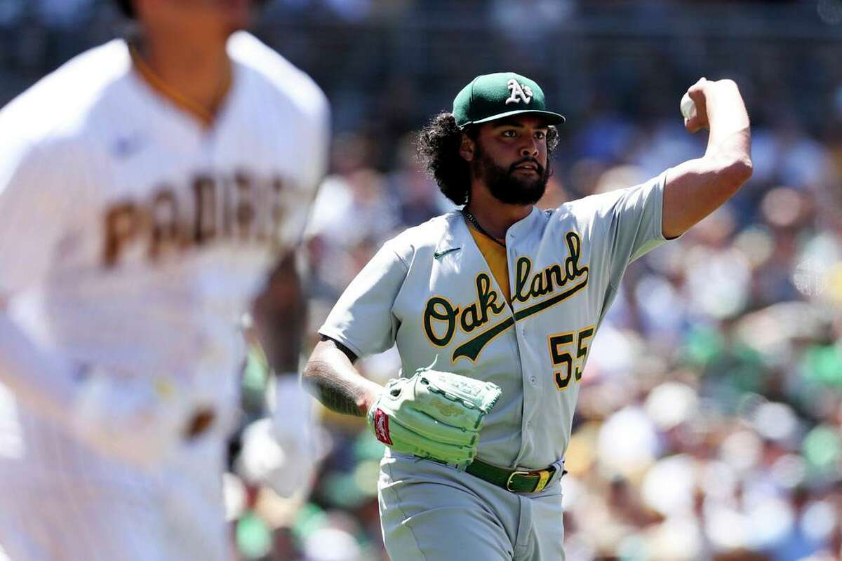 Oakland Athletics starting pitcher Sean Manaea throws out San Diego Padres' Manny Machado at first base in the fourth inning of a baseball game Wednesday, July 28, 2021, in San Diego. (AP Photo/Derrick Tuskan)