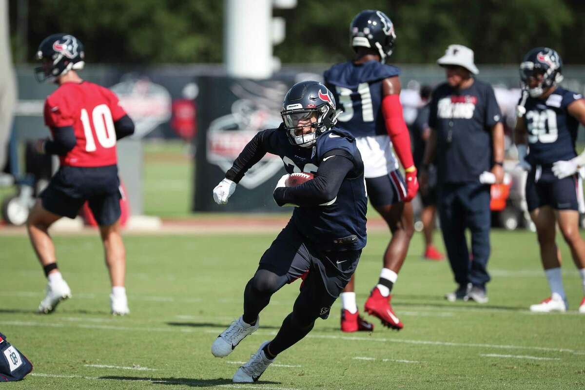 Houston Texans running back Rex Burkhead (28) runs the ball during an NFL training camp football practice Wednesday, July 28, 2021, in Houston.