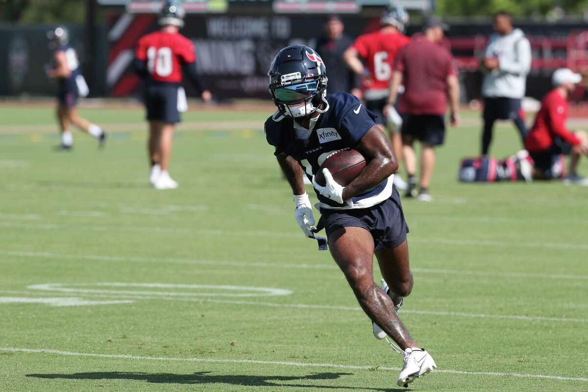 Houston Texans wide receiver Keke Coutee runs up the field after making a catch during an NFL training camp football practice Wednesday, July 28, 2021, in Houston.