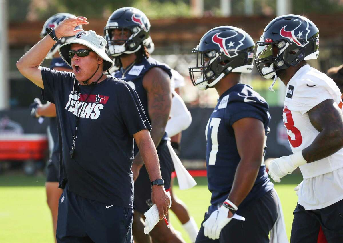 Houston Texans head coach David Culley works with his players during an NFL training camp football practice Wednesday, July 28, 2021, in Houston.