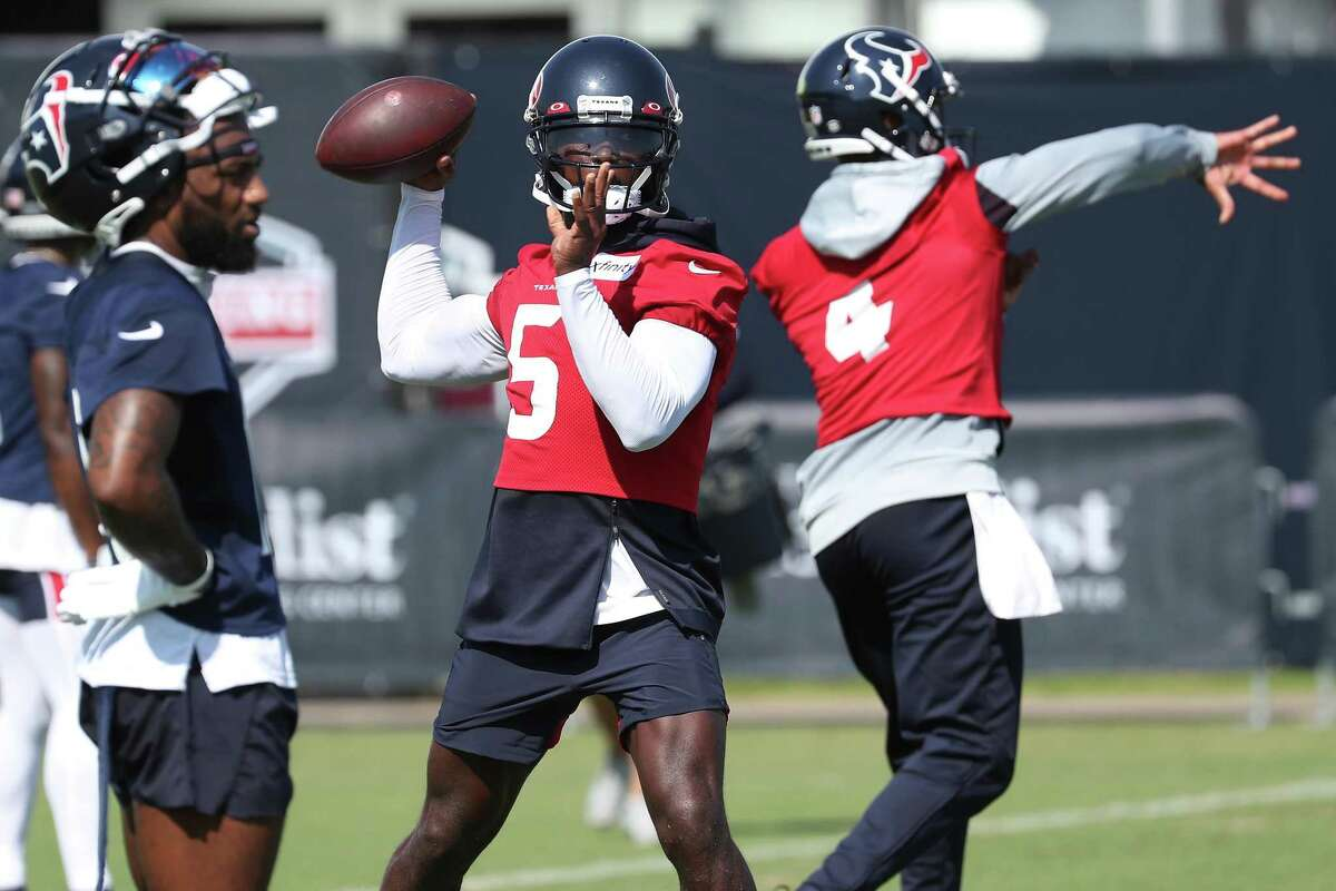 Houston Texans quarterback Tyrod Taylor (5) throws a pass during an NFL training camp football practice Wednesday, July 28, 2021, in Houston.