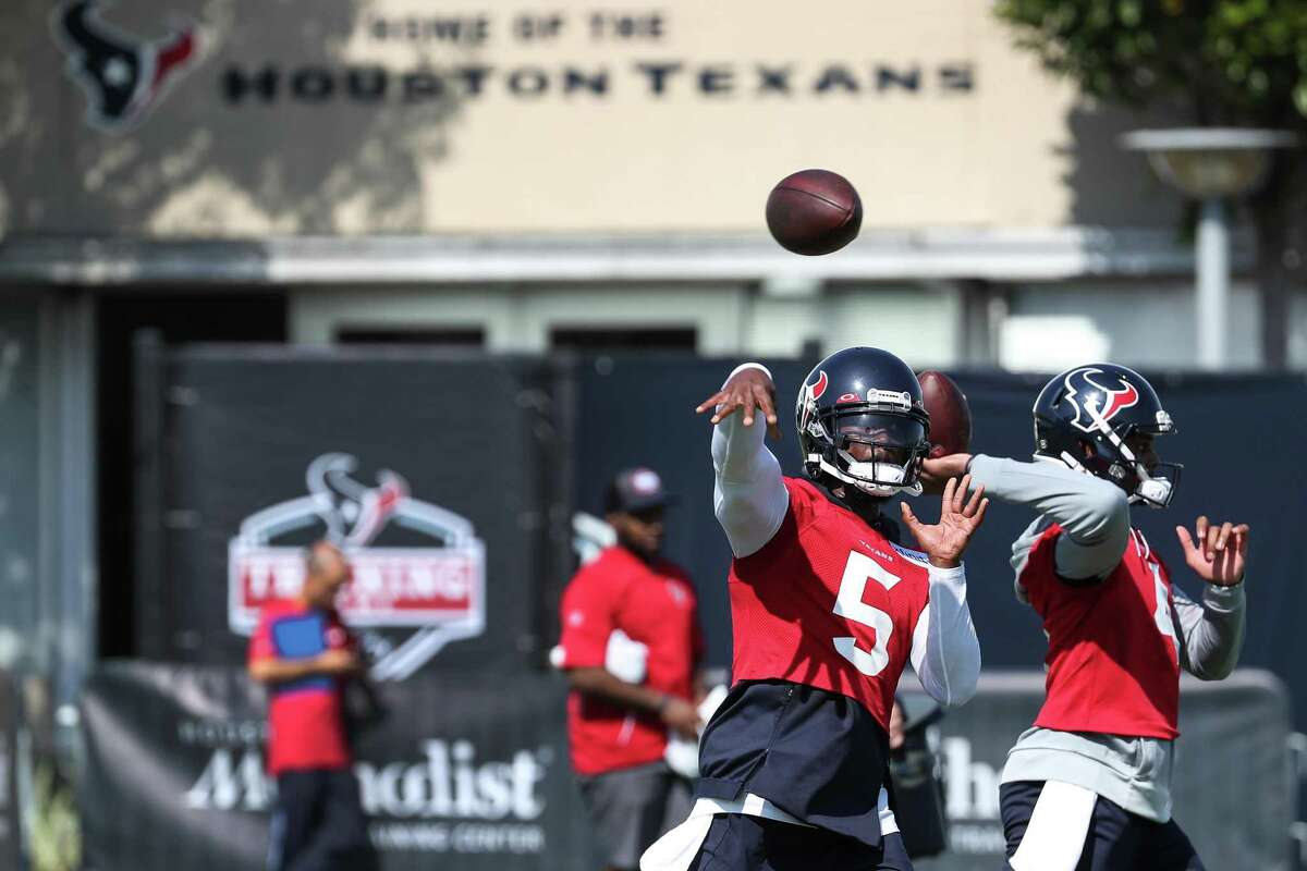 Houston Texans quarterbacks Tyrod Taylor (5) and Deshaun Watson (4) throw passes during an NFL training camp football practice Wednesday, July 28, 2021, in Houston.