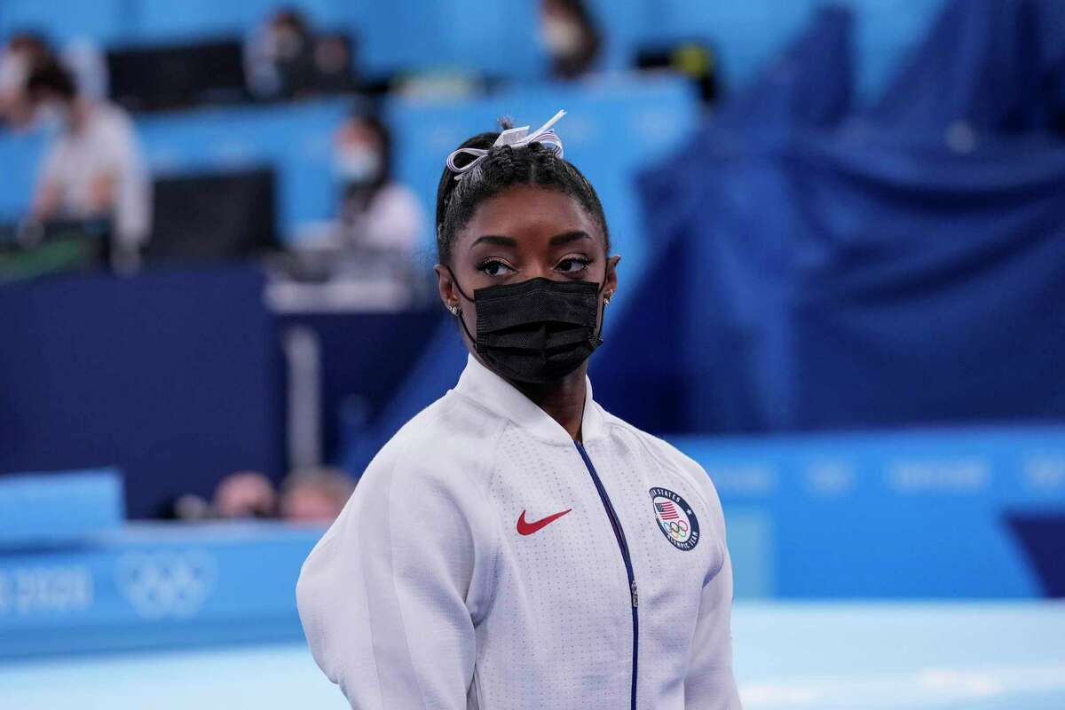 """Simone Biles said after pulling out of Tuesday's team competition, """"We should be out here having fun, and sometimes that's not the case."""""""