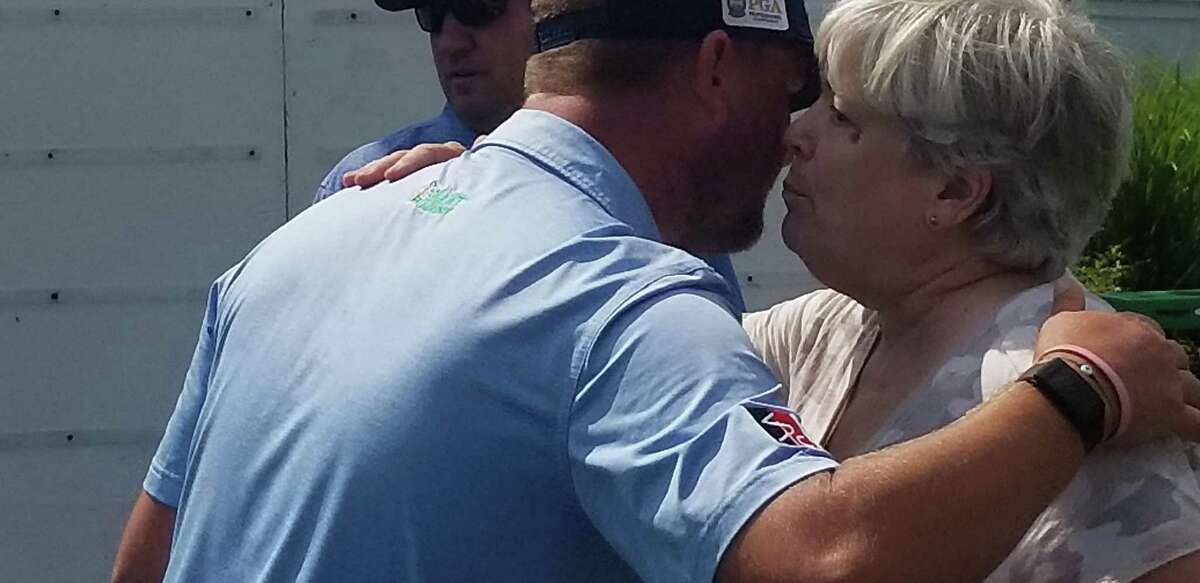 Peter Ballo hugs his mom, Page, after winning the 87th Connecticut Open at Country Club of Darien on Wednesday.