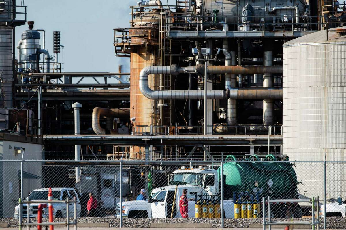 Workers at a LyondellBasell facility in La Porte off of Miller Cut Off Road, Wednesday, July 28, 2021, in La Porte. A chemical leak killed two people and sent 30 to the hospital on Tuesday night at a LyondellBasell facility near La Porte.
