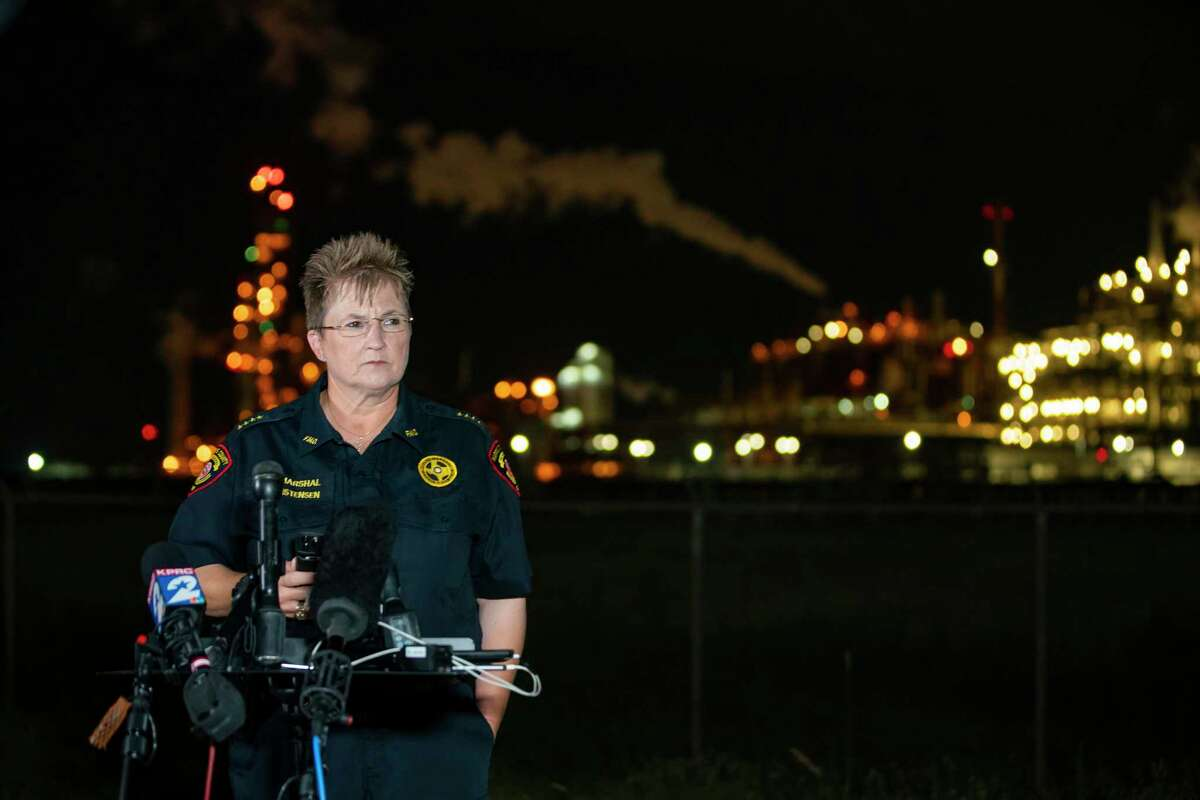 Harris County Fire Marshal Laurie Christensen speaks near the LyondellBasell facility in La Porte off of Miller Cut Off Road, Tuesday, July 27, 2021. An explosion Tuesday evening killed two people at the facility and left several others injured according Christensen.
